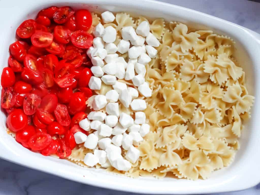 pasta, mozzarella, and tomatoes in a serving dish