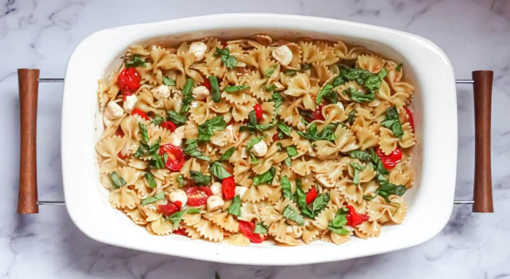 Caprese pasta salad recipe tossed with balsamic dressing. An easy bbq side dish for the summer.