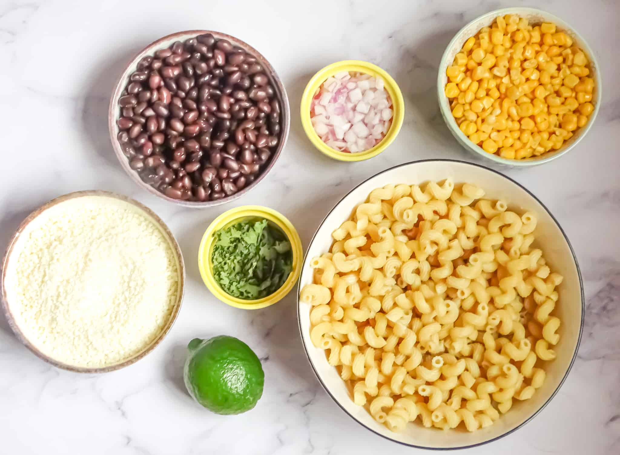 Mexican street corn pasta salad ingredients in bowls