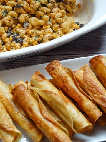 easy chicken taquitos served with mexican street corn pasta salad