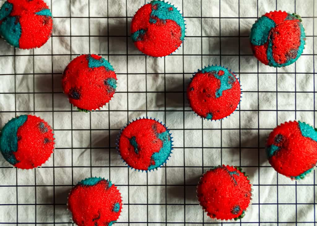 Patriotic cupcakes on a cooling rack, a tasty 4th of July dessert.