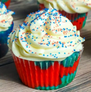 firecracker explosion cupcake with cream cheese frosting and red white and blue sprinkles