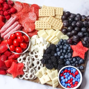 patriotic charcuterie board with red, white and blue foods
