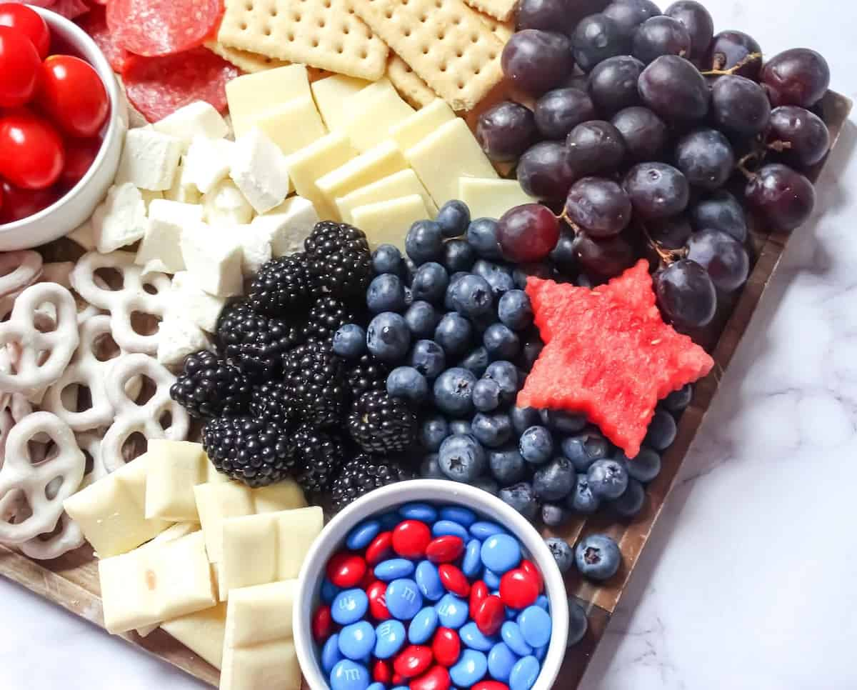 blue foods on a red, white and blue snack board