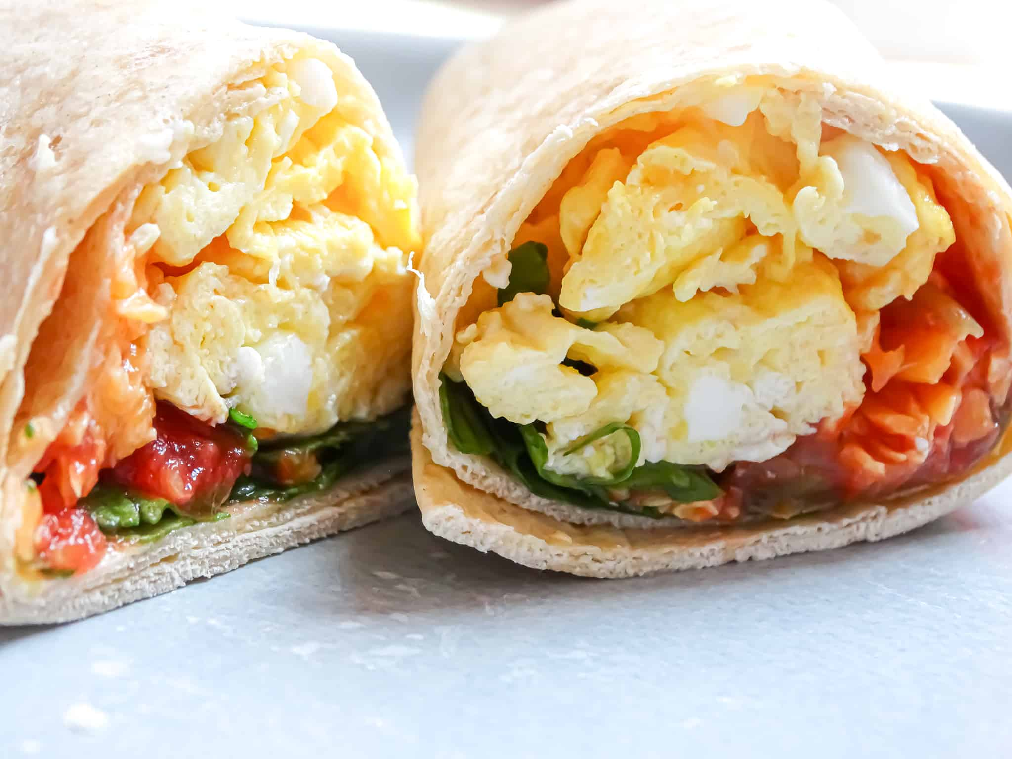 inside of a spinach egg breakfast burrito; a healthy breakfast idea for the family