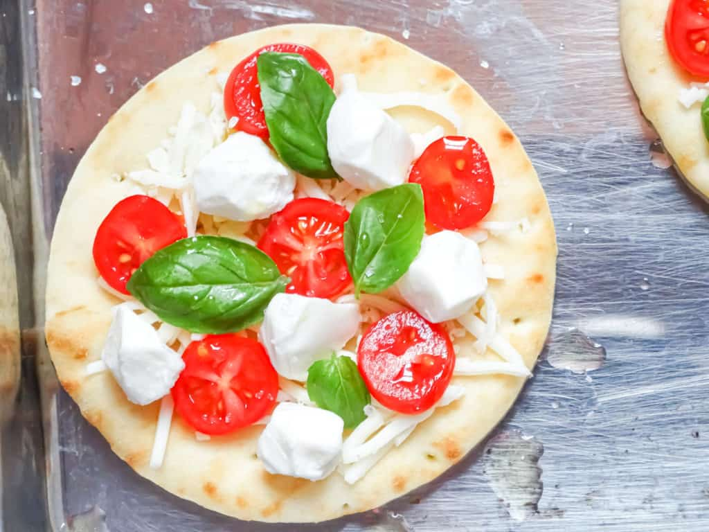 caprese lunch with tomatoes, basil, and mozzarella balls