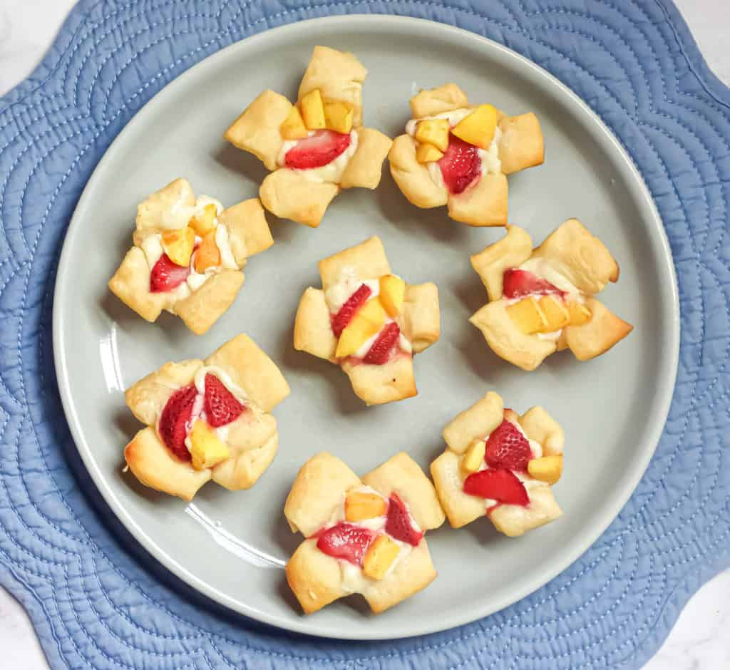 mini croissant cups filled with danish cream filling and strawberry and peach