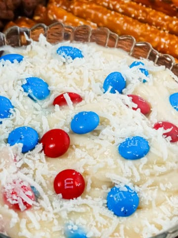 white patriotic dip with chocolate bites and coconut shreds