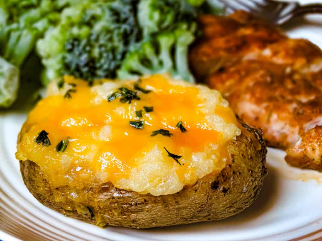 cheddar twice baked potato topped with chives