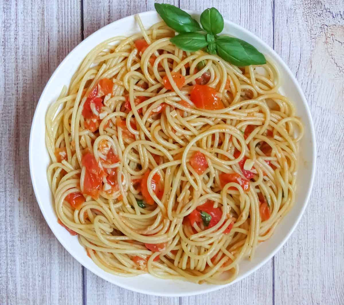 fresh tomato sauce with pasta and basil in a plate