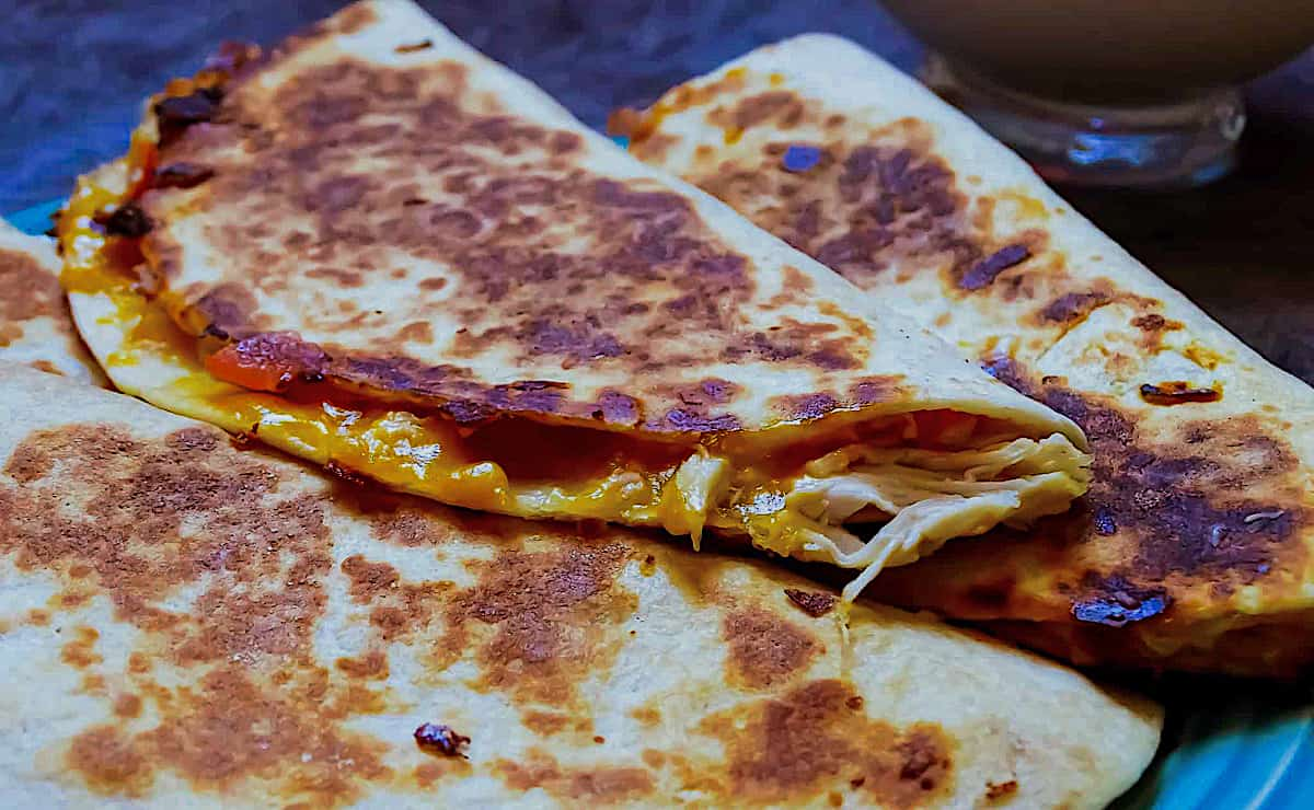 a stack of cheese quesadillas on a plate