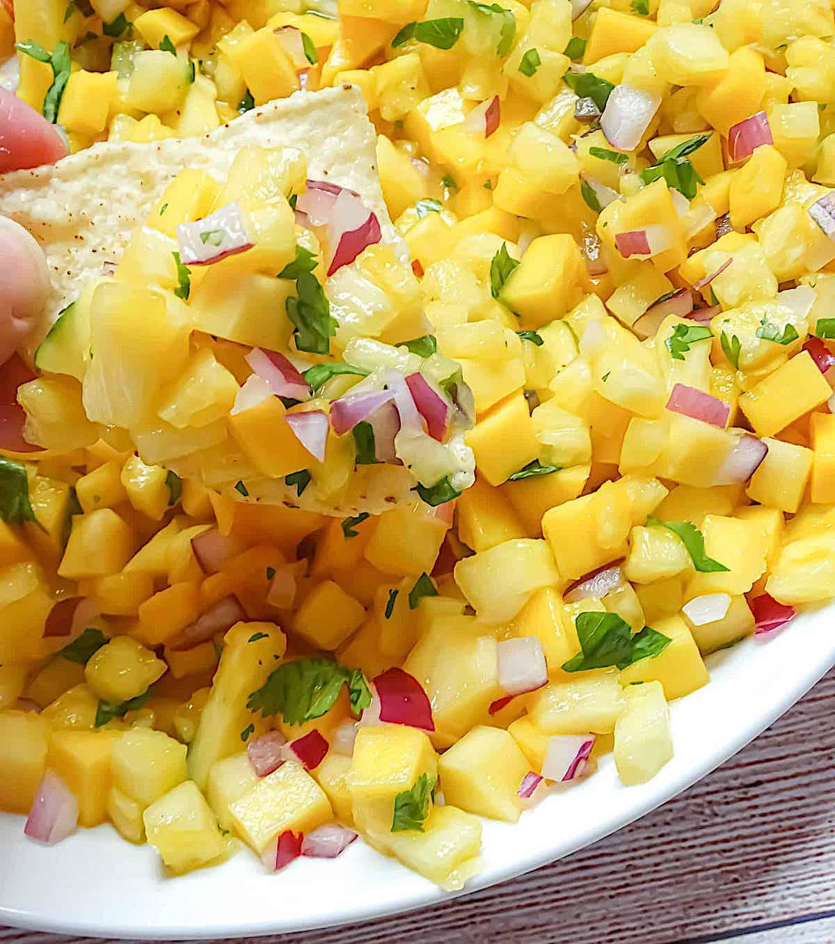 pineapple mango salsa in a white bowl
