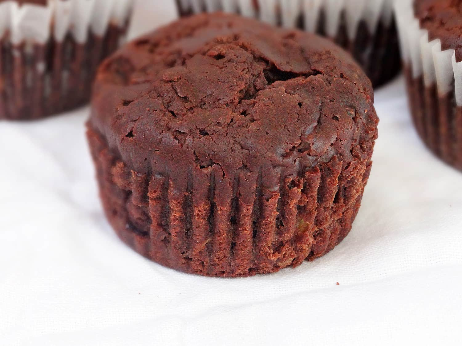 close up of a chocolate zucchini muffin
