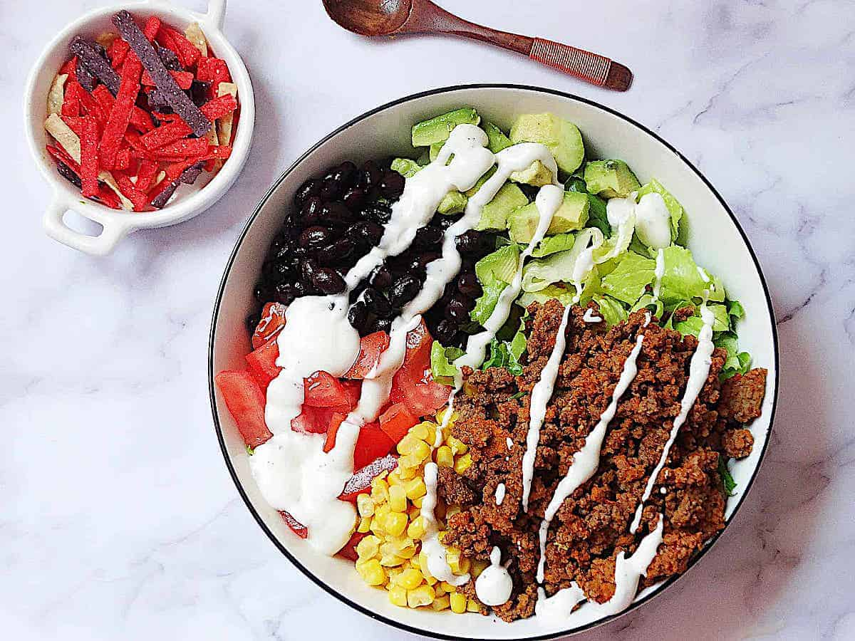 healthy taco salad drizzled with ranch dressing