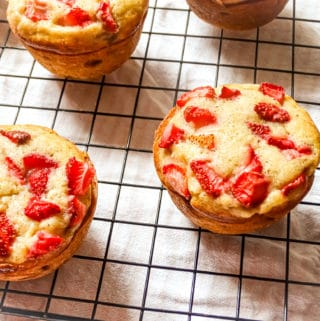the best strawberry banana muffins on a wire rack