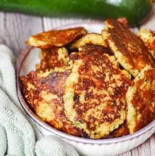 cheesy zucchini fritters in a bowl
