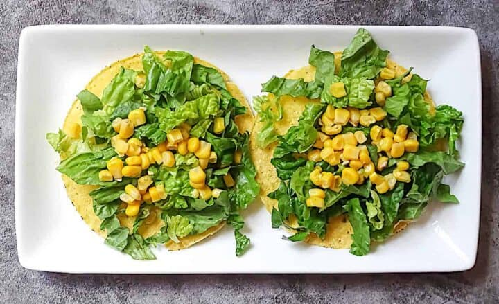 tostada with romaine lettuce and corn