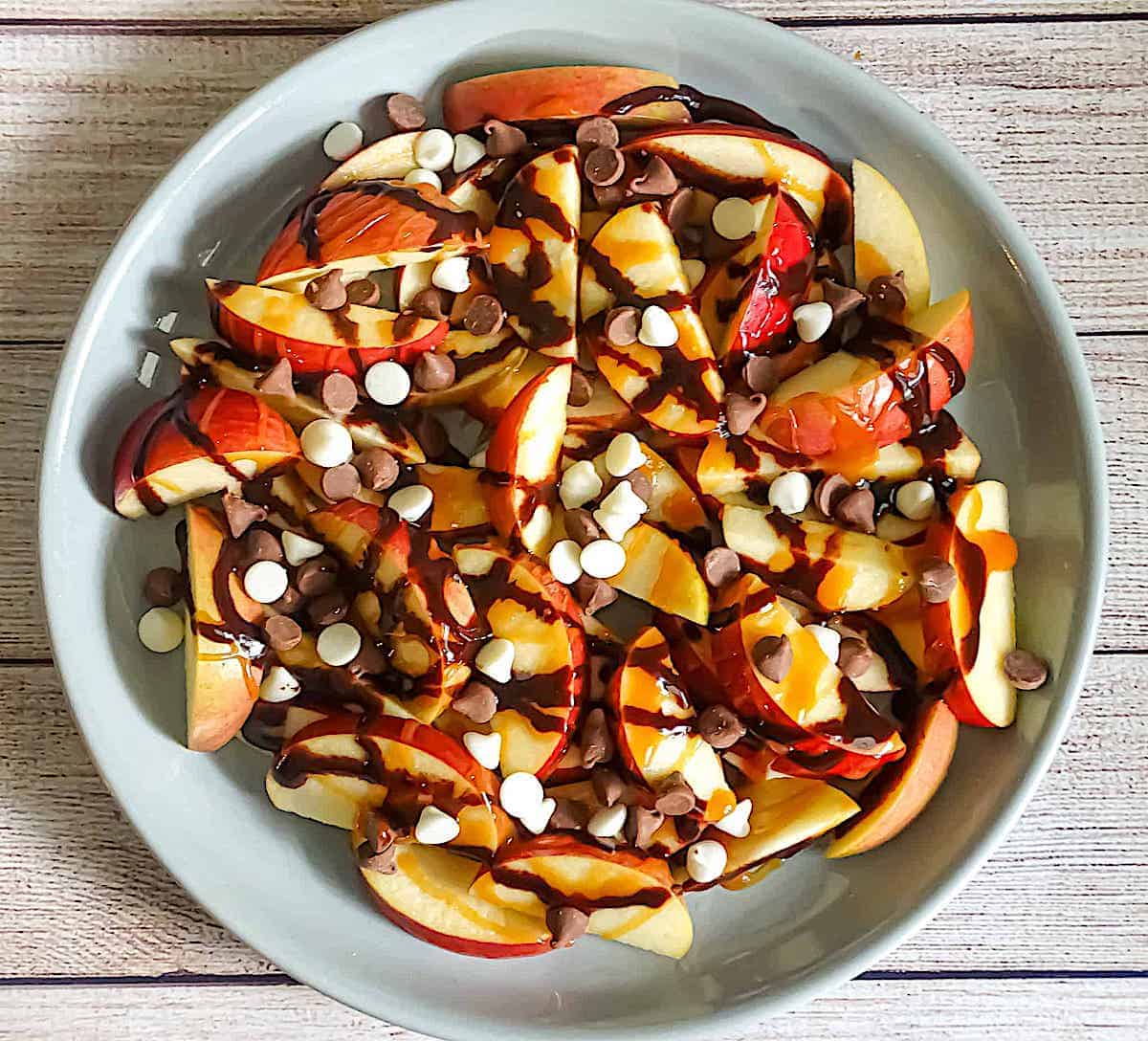 apple nachos with caramel, chocolate sauce and chocolate chips as an after school snack idea