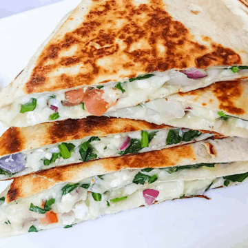 mediterranean quesadillas in a stack on a white plate