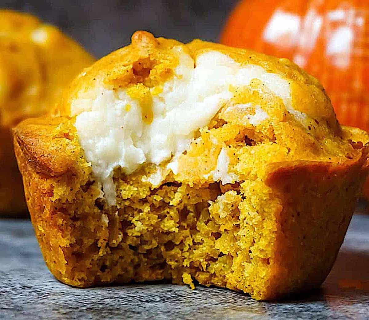 a bitten into cream cheese muffin