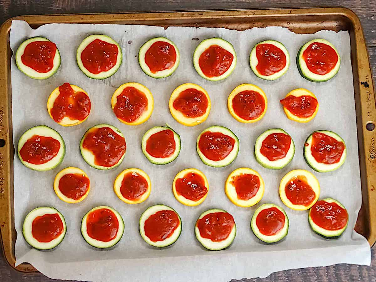 zucchini slices topped with pizza sauce