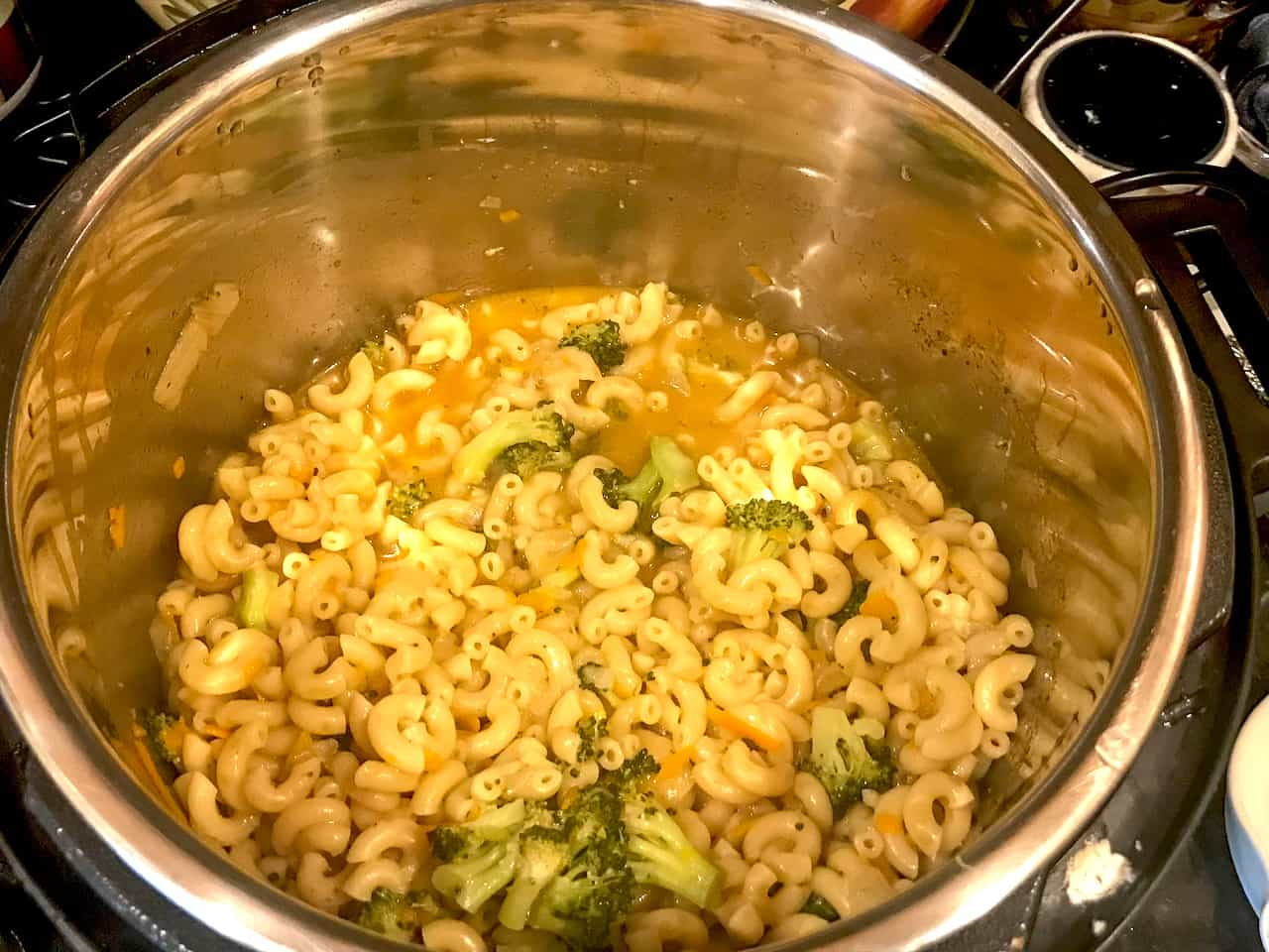 pasta, broccoli, spices, and broth in an instant pot
