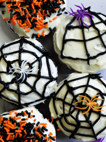 Halloween donuts with spider webs, spiders, and festive sprinkles
