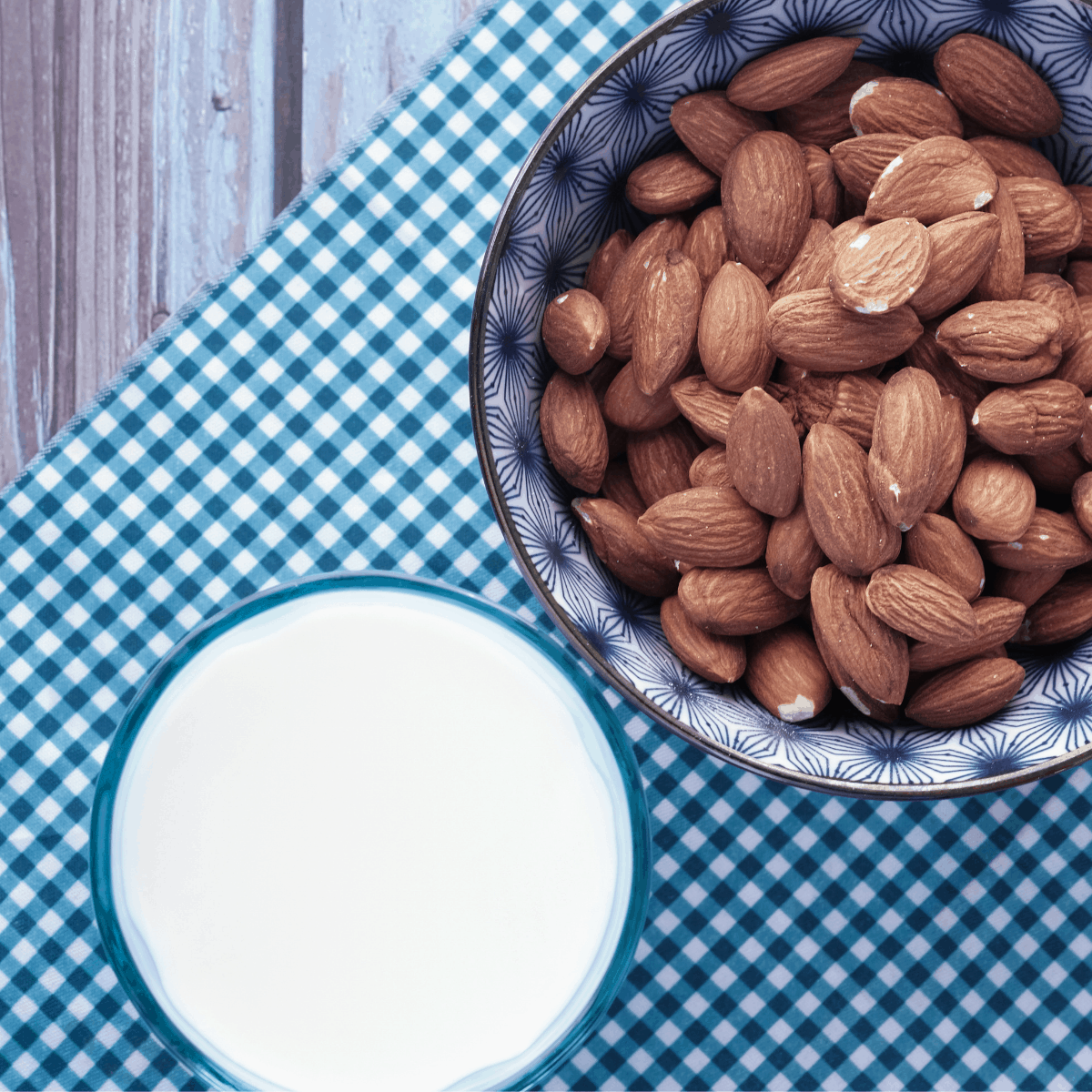 almond milk substitute with almonds in a cup