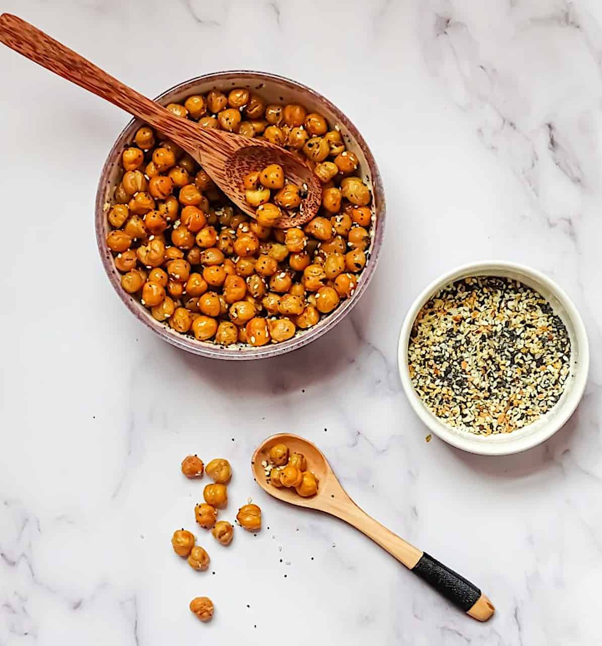 crispy roasted chickpeas on a white background with everything bagel seasoning
