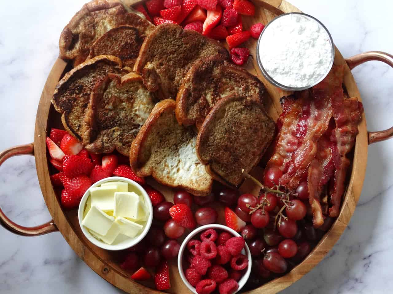 french toast breakfast charcuterie board on a white background
