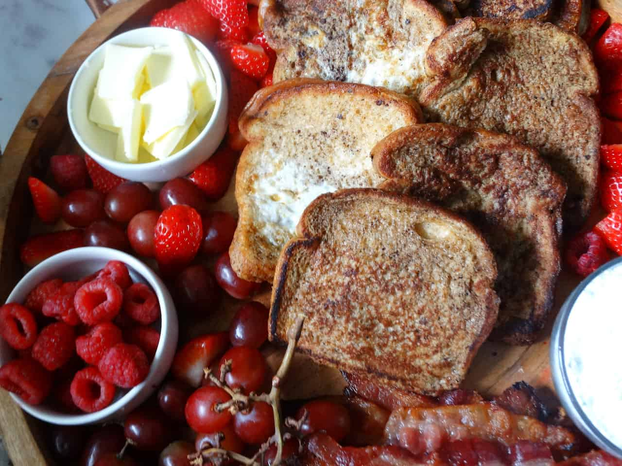 french toast breakfast charcuterie board with fresh fruit and butter