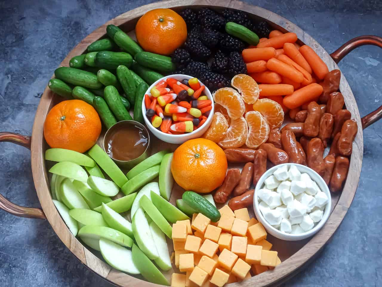 a healthy Halloween charcuterie board filled with fruits and vegetables
