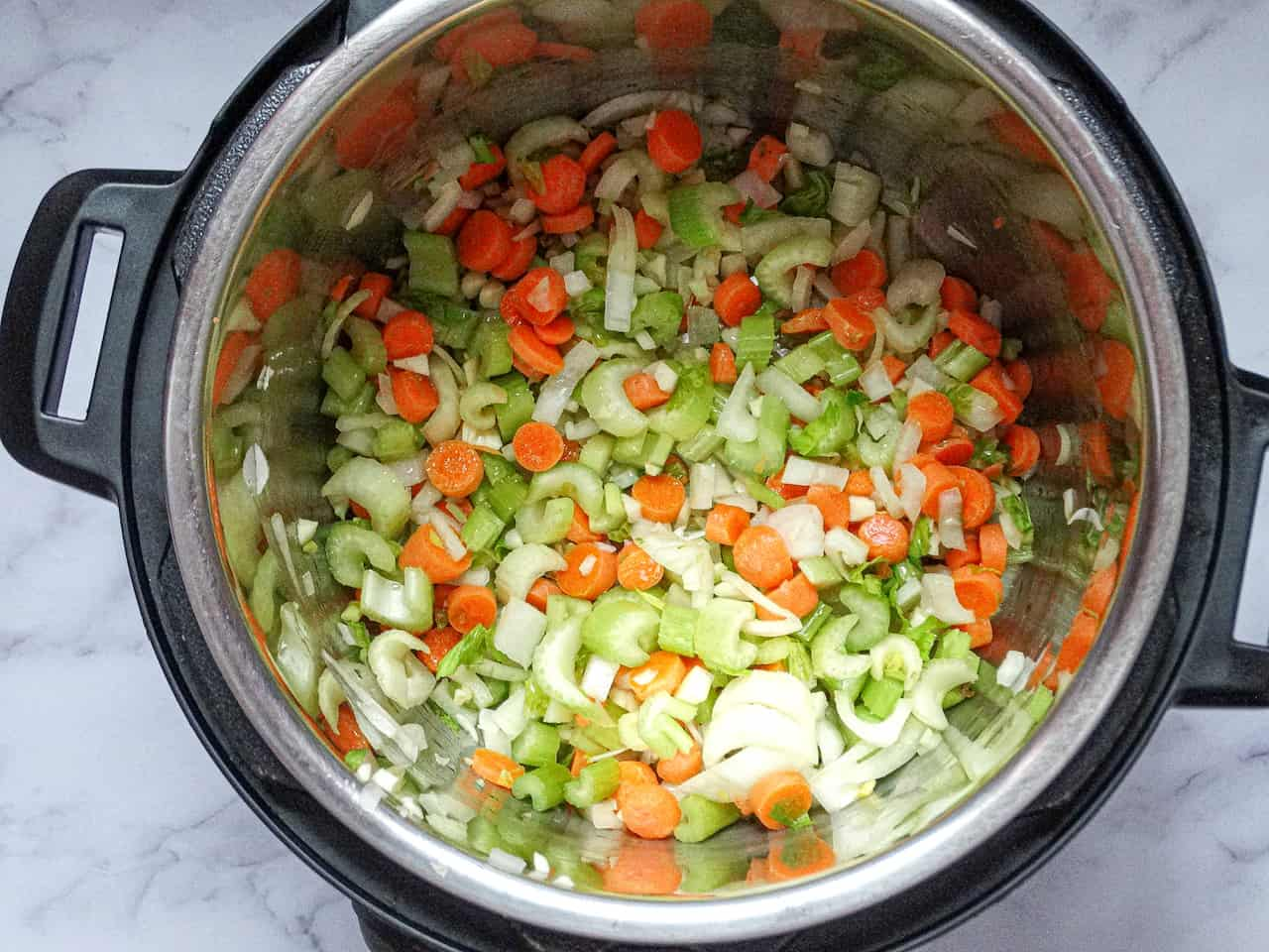 carrots, celery, onions, and garlic in an instant pot