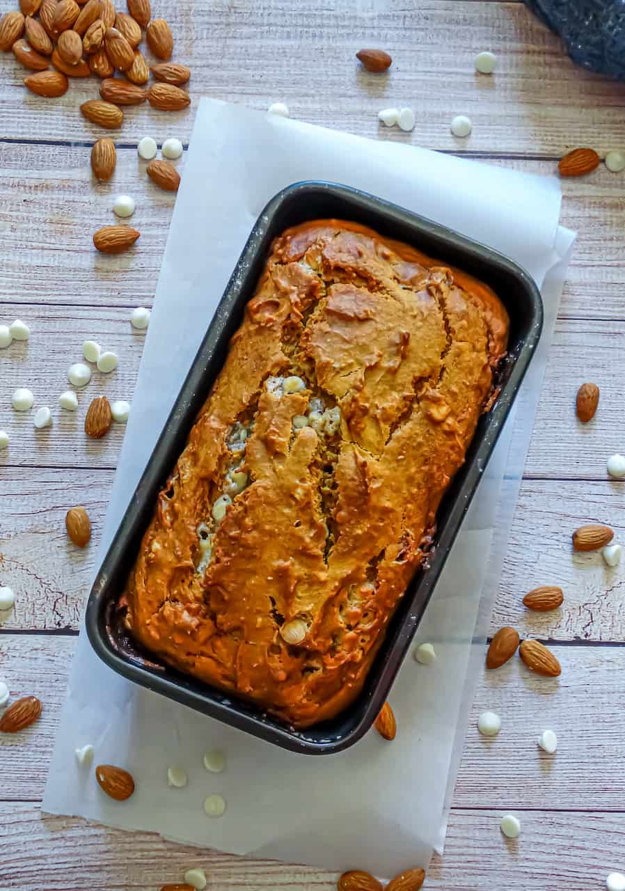 chocolate pumpkin bread in a loaf pan on parchment paper