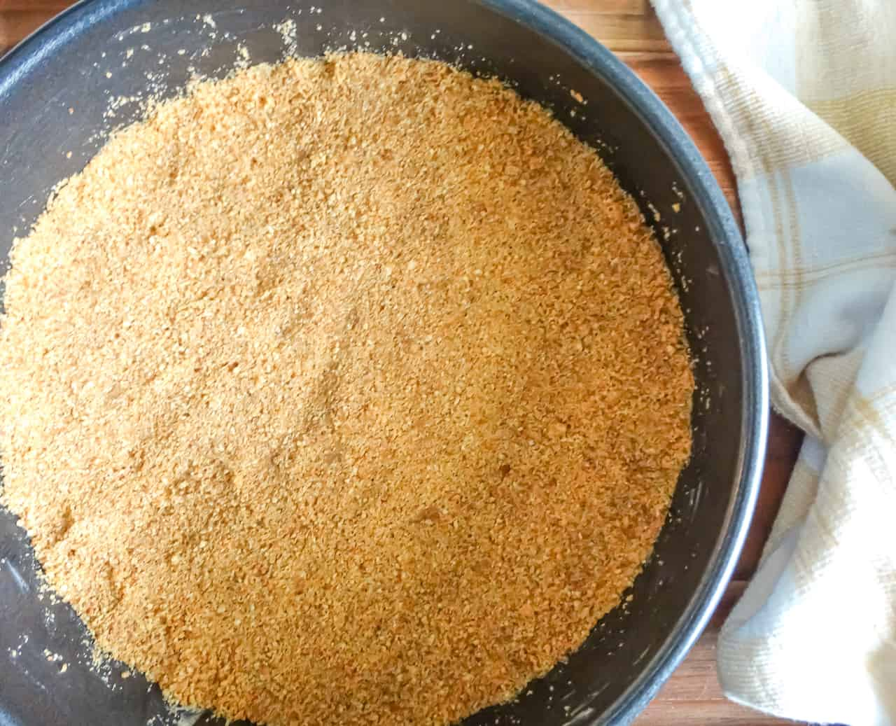 nutmeg spiced graham cracker crust for cheesecake in a pan