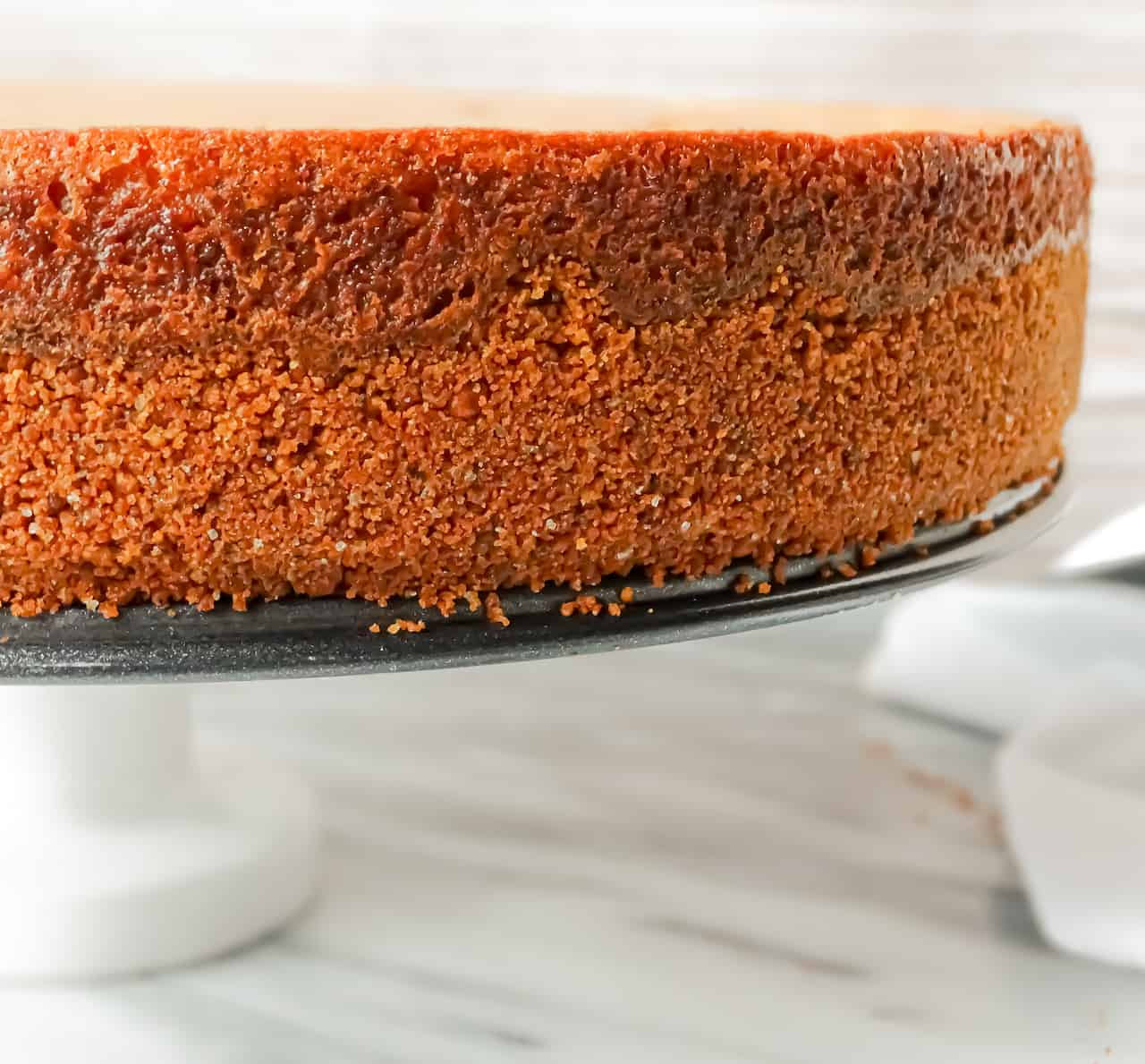 the nutmeg crust close up of a pumpkin spice cheesecake