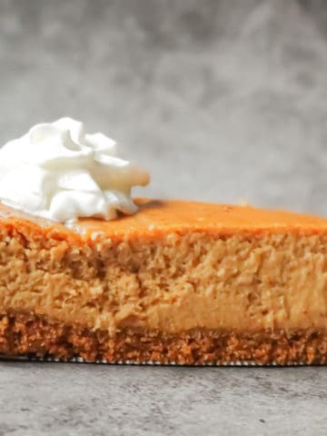 pumpkin spice cheesecake slice on a gray background