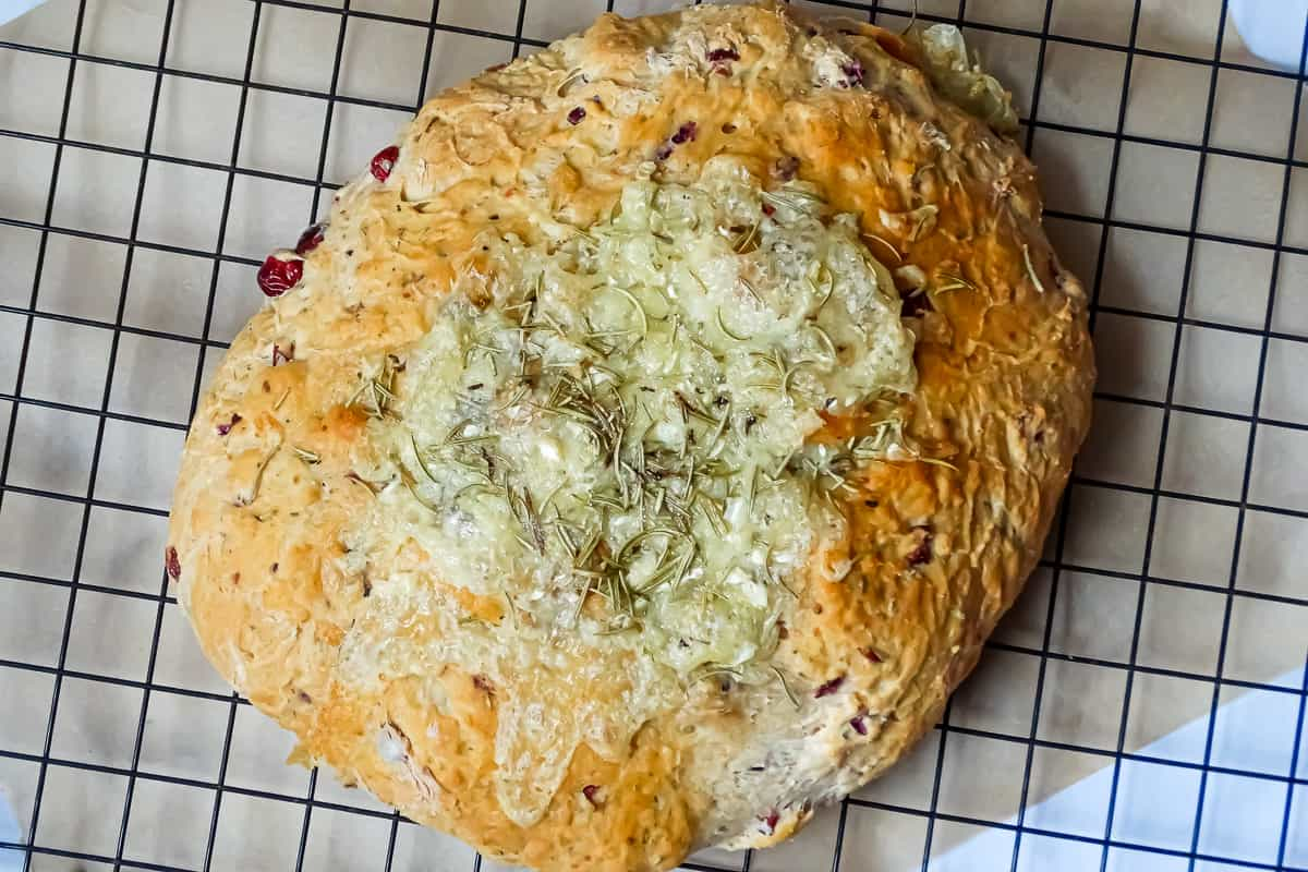 baked brie cranberry bread on a wire cooling rack