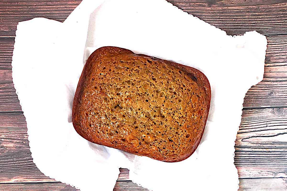 loaf of bread machine zucchini bread with applesauce and honey on a white towel