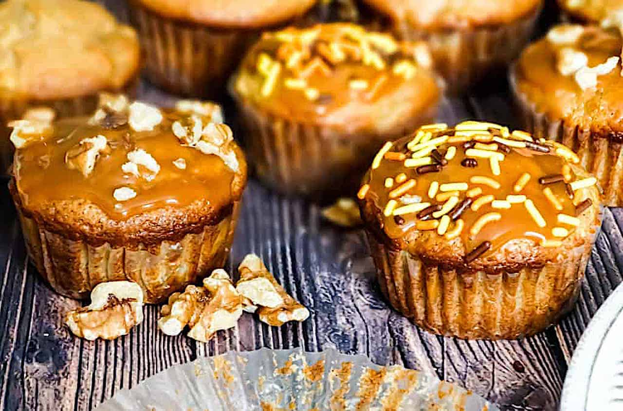 caramel apple muffins with sprinkles, caramel and nut topping