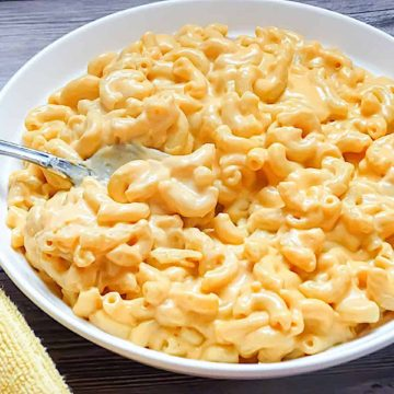 cream mac and cheese in a white bowl