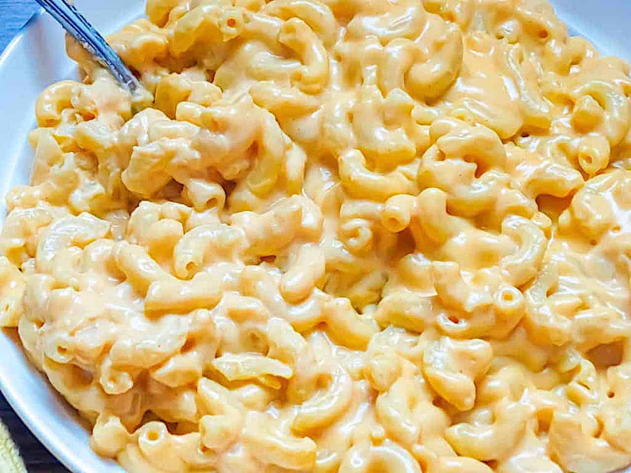 homemade creamy mac and cheese in a white bowl