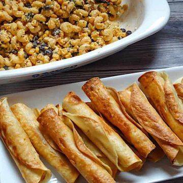 easy chicken taquitos in a white plate
