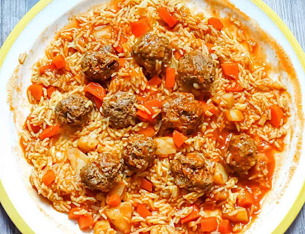 Syrian Kebab Hindi with lamb meatballs, potatoes, carrots, and basmati rice