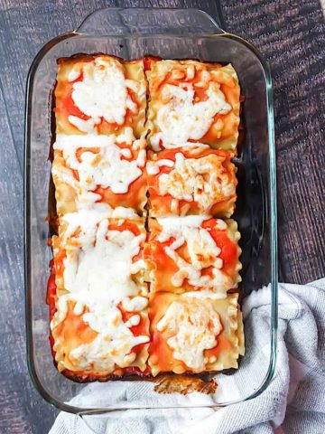 lasagna roll ups cooked and in a glass pan