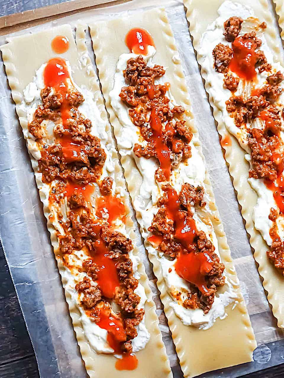 asagna roll ups unrolled and filled with cream filling and beefy tomato mixture