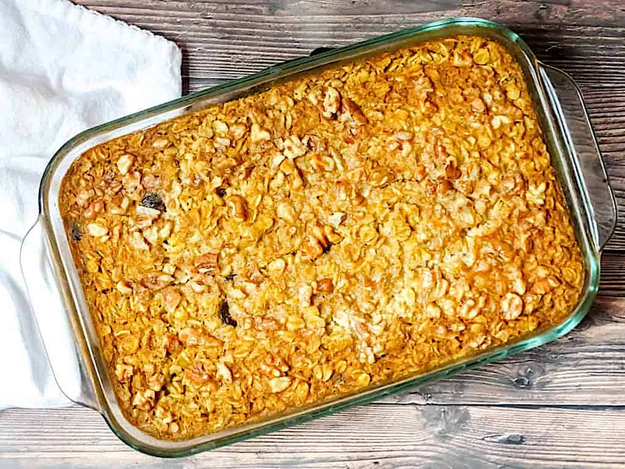 cooked pumpkin baked oatmeal in a glass baking dish