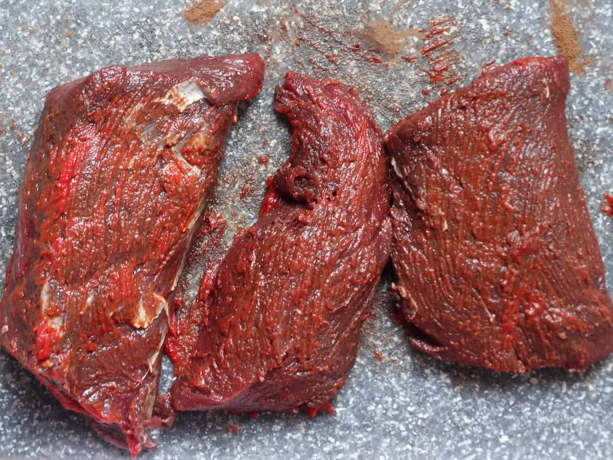 venison backstrap rubbed with spices and tomato paste