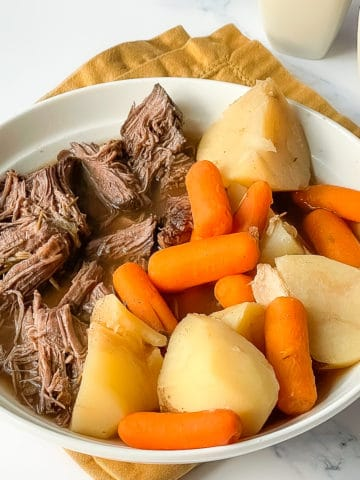 Instant Pot Venison Roast with potatoes and carrots in a white bowl