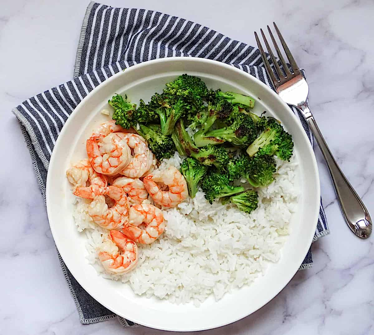 shrimp, broccoli and rice on a white plate